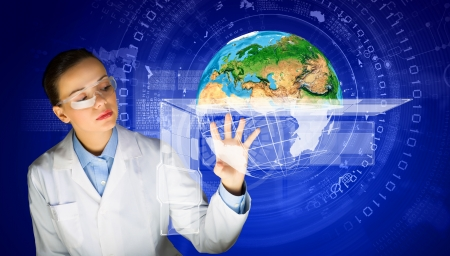 furnished: Image of young woman scientist in goggles against media screen  Elements of this image are furnished by NASA