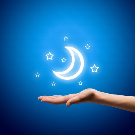 stars: Close up if human hands holding moon Stock Photo