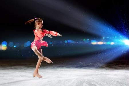 figure skater: Little girl figure skating at sports arena