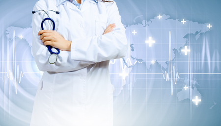 Image of doctor holding stethoscope against media background