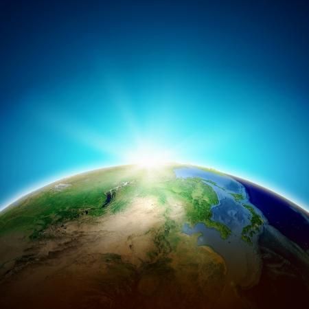 De zon stijgt boven de planeet Aarde Conceptuele foto Elementen van dit beeld zijn geleverd door NASA
