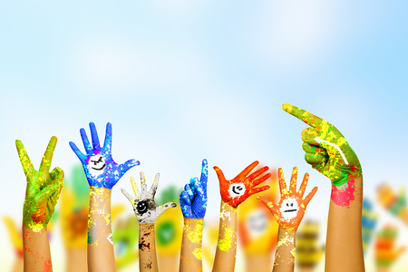 Image of human hands in colorful paint with smiles photo