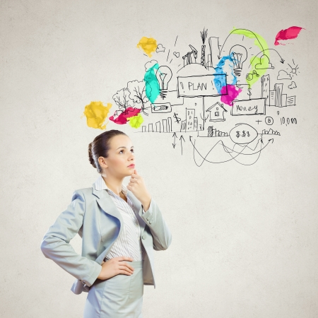Image of thoughtful businesswoman with business sketch at background photo