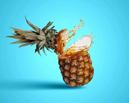 Image of fresh pineapple in juicy splashes photo