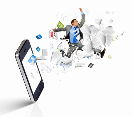 Image of businessman jumping out of mobile phone photo