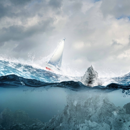 Submerged ocean view with yacht floating above photo