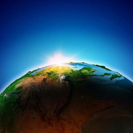 Sun rising above Earth planet Stock Photo - 23436072