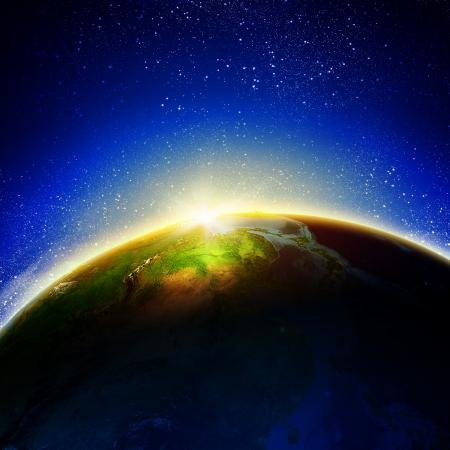 Sun rising above Earth planet Stock Photo - 23436083