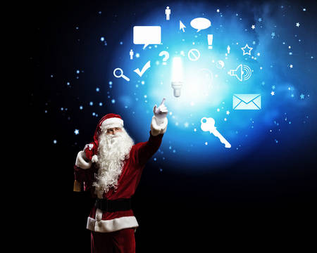 Image of Santa Claus in red costume  Communication concept photo