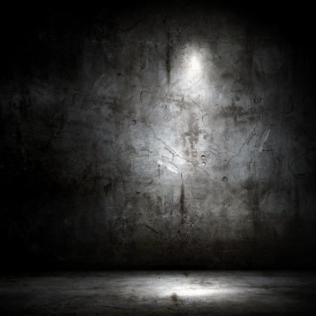 soledad: Imagen de fondo de la pared oscura con la luz