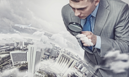 curious: Image of businessman examining objects with magnifier