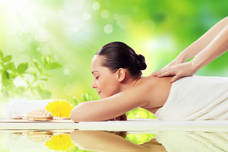 Image of young woman relaxing in spa salon photo
