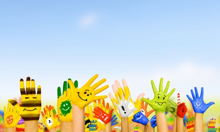 Image of human hands in colorful paint with smiles Reklamní fotografie