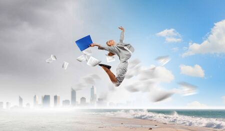 joyfully: Image of businesswoman jumping joyfully  Summer vacation