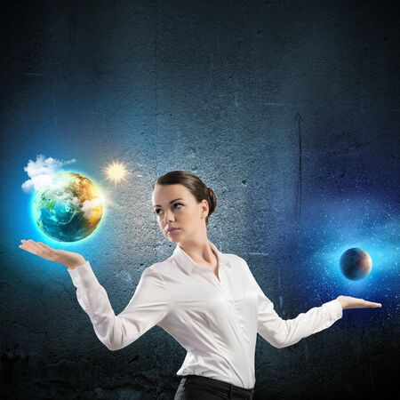 discover: Image of young woman holding items on palms Stock Photo