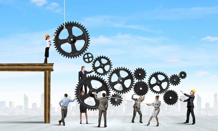 Conceptual image of businessteam working cohesively  Interaction and unity photo