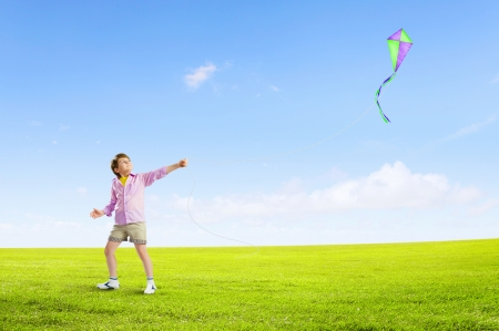 children running: Little boy playing with kite on meadow  Childhood concept