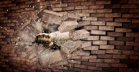 Human hand breaking brick wall  Strength and power