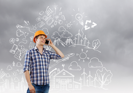 Image of man engineer talking on mobile phone photo