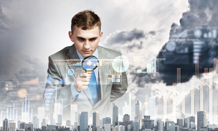 examining: Image of businessman examining objects with magnifier