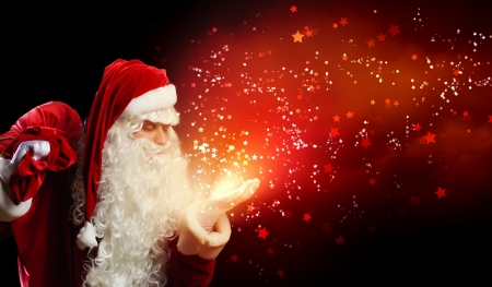 santa: Image of Santa Claus in red costume against dark background Stock Photo
