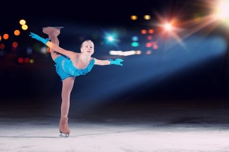 Little girl figure skating at sports arena Banco de Imagens - 23667202