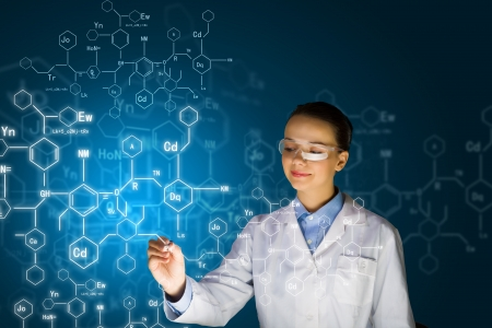 medical student: Young woman researcher in medical uniform drawing chemistry formulas Stock Photo