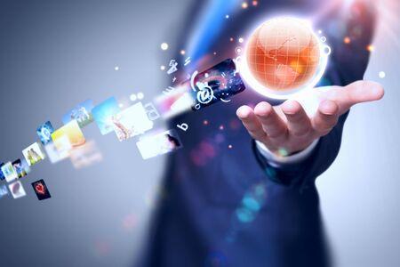 holography: Image of globe on palm of businessman  Media technologies Stock Photo