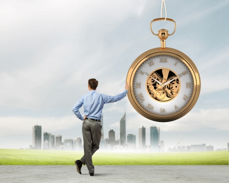 Image of young businessman and pocket watch  Time concept Zdjęcie Seryjne
