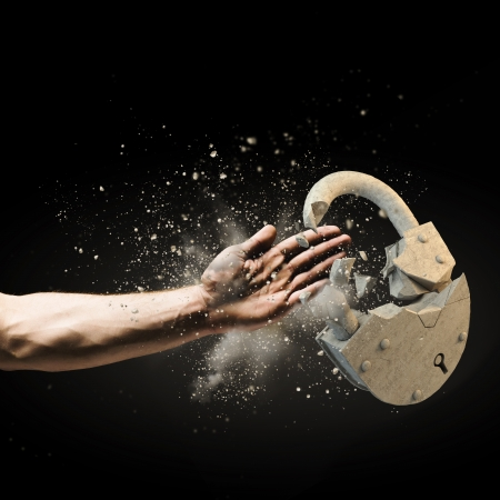 Image of human hand breaking stone lock