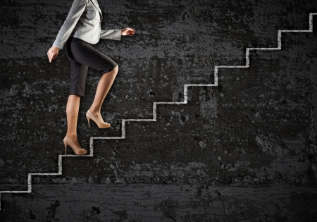 corporate woman: Image of businesswoman climbing career ladder  Success and achievement Stock Photo