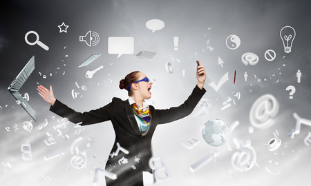 aggressively: Angry businesswoman screaming aggressively in mobile phone Stock Photo