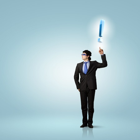 Image of young businessman with exclamation mark photo