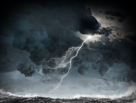 Image of dark night with lightning above stormy sea photo