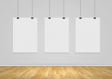 Three white blank banners hanging on wall  Place for text Stock Photo