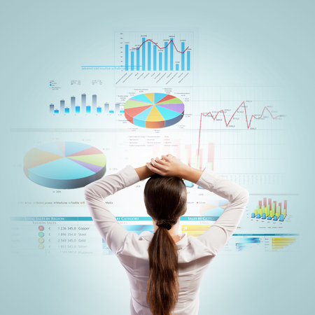 Back view of businesswoman looking at diagram illustration Stock Photo