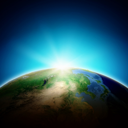 Sun rising above Earth planet  Conceptual photo  Elements of this image are furnished by NASA photo