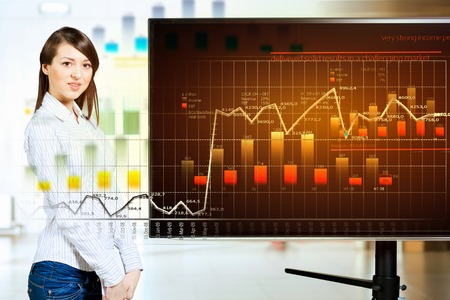 Image of young woman making presentation on screen