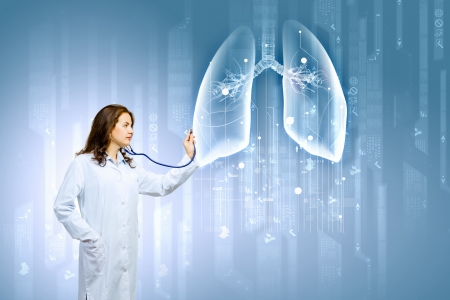 Image of young woman doctor touching icon of media screen photo