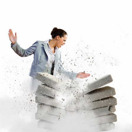 typist: Image of businesswoman crushing with hand pile of keyboards Stock Photo