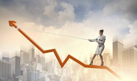 Image of businesswoman standing on graph  Income and profit photo