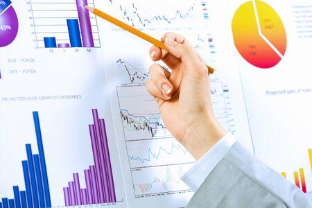 document management: Close up image of human hand holding pencil  Marketing presentation