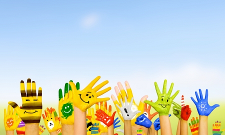 smiley face: Image of human hands in colorful paint with smiles Stock Photo