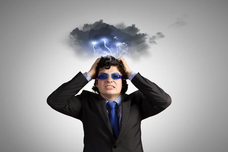 Image of depressed businessman tearing his hair photo
