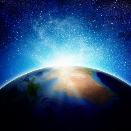 Sun rising above Earth planet  Conceptual photo   Stock Photo - 23844058