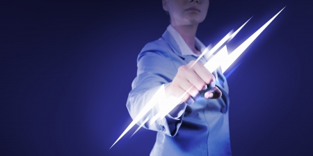 determinism: Image of powerful businesswoman holding lightning in fist Stock Photo