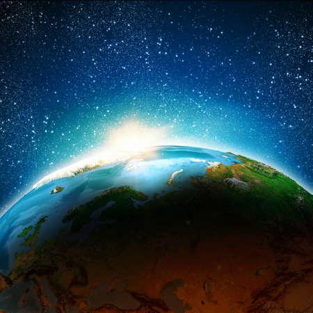 Sun rising above Earth planet Stock Photo - 23974470