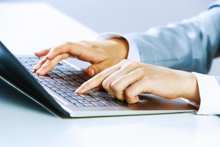 typist: Close up image of businesswoman hands typing on keyboard