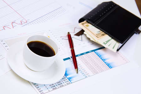 Close up image of office workplace with cup of coffee and documents photo