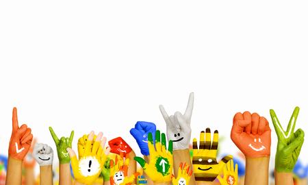 face paint: Image of human hands in colorful paint with smiles Stock Photo